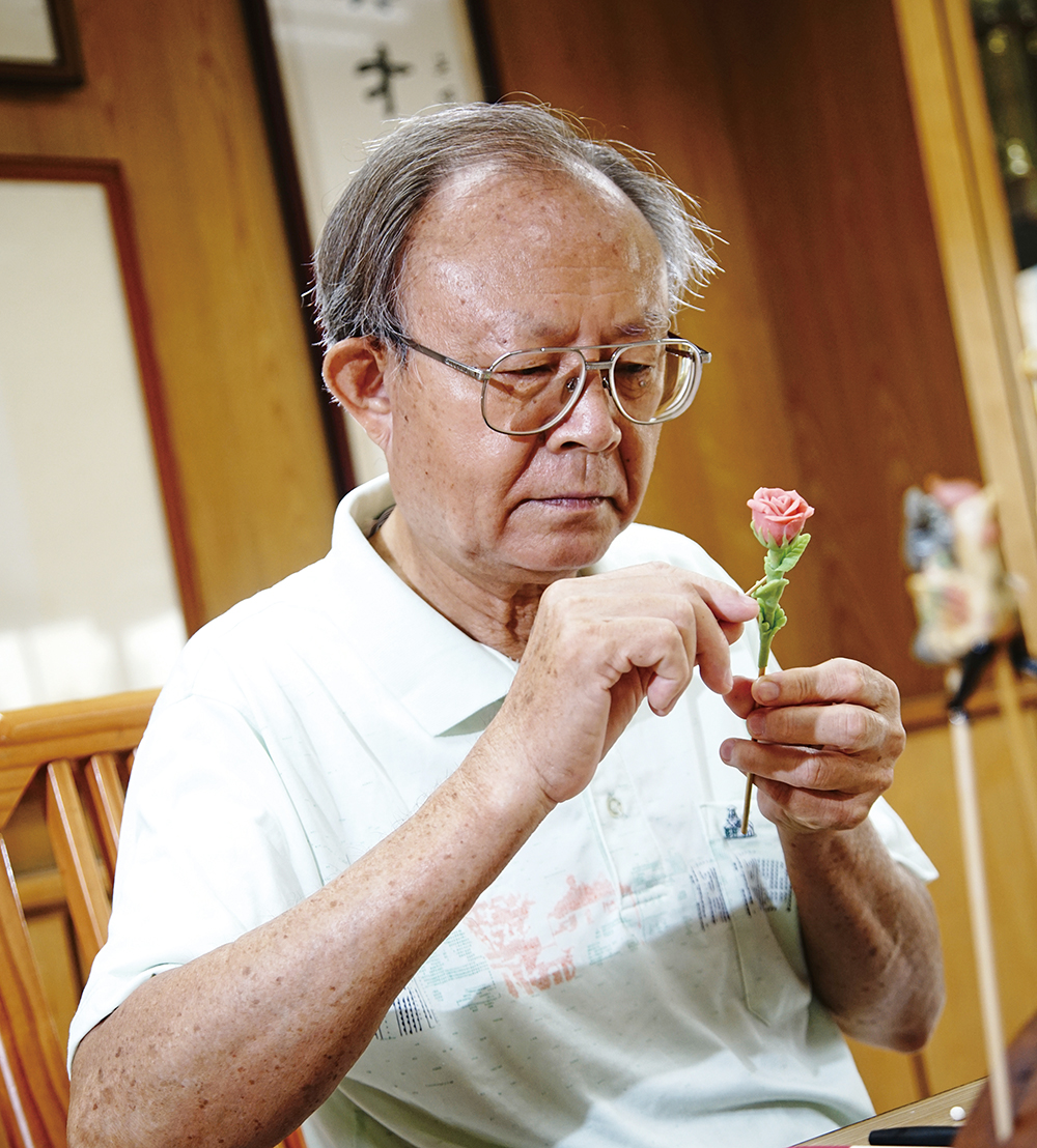 Mr. Chen Yi-jin's passion for dough-figurine artistry has never dimmed.